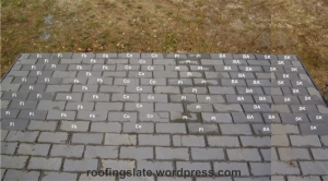 Experimental roof with tiles of slate treated with different products and treatments